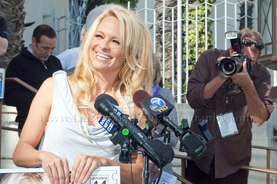 1030w Actress/Animal Rights Activist  Pamela Anderson and Game Show Host and Animal Rights Activist Bob Barker unveil PETA's new Vegetarian Icons Photo Stamp collectors' sheet at the Hollywood Post Office 11/29/2011. The USPS-approved postage stamps feature famous vegetarians dead and living incluidng Leonardo da Vinci, Ellen DeGeneres, Pamela Anderson, Bob Barker and Mohandes Gandhi.
