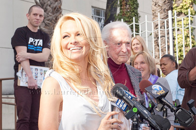 1029w Actress/Animal Rights Activist  Pamela Anderson and Game Show Host and Animal Rights Activist Bob Barker unveil PETA's new Vegetarian Icons Photo Stamp collectors' sheet at the Hollywood Post Office 11/29/2011. The USPS-approved postage stamps feature famous vegetarians dead and living incluidng Leonardo da Vinci, Ellen DeGeneres, Pamela Anderson, Bob Barker and Mohandes Gandhi. Pamela Anderson smiles and she and Bob Barker takes questions from the press regarding PETA's PhotoStamp Collectors' Stamps.