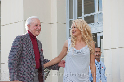 1004w  Actress/Animal Rights Activist  Pamela Anderson and Game Show Host and Animal Rights Activist Bob Barker unveil PETA's new Vegetarian Icons Photo Stamp collectors' sheet at the Hollywood Post Office 11/29/2011. The USPS-approved postage stamps feature famous vegetarians dead and living incluidng Leonardo da Vinci, Ellen DeGeneres, Pamela Anderson, Bob Barker and Mohandes Gandhi. Pamela Anderson greets Bob Barker as they arrive at the PhotoStamp launch.
