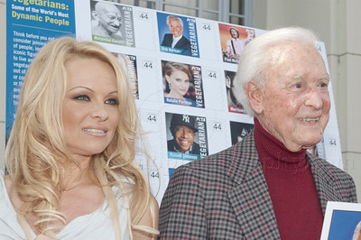 1035w  Actress/Animal Rights Activist  Pamela Anderson and Game Show Host and Animal Rights Activist Bob Barker unveil PETA's new Vegetarian Icons Photo Stamp collectors' sheet at the Hollywood Post Office 11/29/2011. The USPS-approved postage stamps feature famous vegetarians dead and living incluidng Leonardo da Vinci, Ellen DeGeneres, Pamela Anderson, Bob Barker and Mohandes Gandhi.