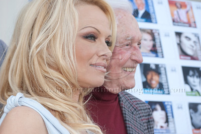 1006w Actress/Animal Rights Activist  Pamela Anderson and Game Show Host and Animal Rights Activist Bob Barker unveil PETA's new Vegetarian Icons Photo Stamp collectors' sheet at the Hollywood Post Office 11/29/2011. The USPS-approved postage stamps feature famous vegetarians dead and living incluidng Leonardo da Vinci, Ellen DeGeneres, Pamela Anderson, Bob Barker and Mohandes Gandhi.