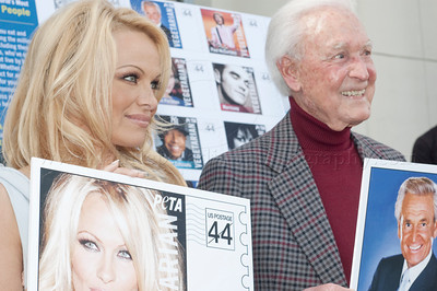1037w Actress/Animal Rights Activist  Pamela Anderson and Game Show Host and Animal Rights Activist Bob Barker unveil PETA's new Vegetarian Icons Photo Stamp collectors' sheet at the Hollywood Post Office 11/29/2011. The USPS-approved postage stamps feature famous vegetarians dead and living incluidng Leonardo da Vinci, Ellen DeGeneres, Pamela Anderson, Bob Barker and Mohandes Gandhi.