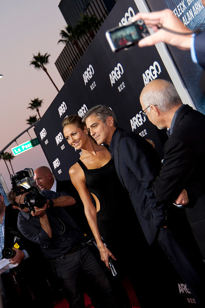 """BEVERLY HILLS, CA - OCTOBER 04: Stecy Keibler (L) and actor George Clooney arrive at the premiere of Warner Bros. Pictures' """"Argo"""" at AMPAS Samuel Goldwyn Theater onThursday, October 4, 2012 in Beverly Hills, California. (Photo by Tom Sorensen/Moovieboy Pictures)"""