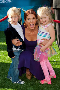 HOLLYWOOD, CA - JUNE 18: Actress Poppy Montgomery (C) arrives at Disney Pixar's 'Brave' World Premiere at Dolby Theatre on June 18, 2012 in Hollywood, California. (Photo by Tom Sorensen/Moovieboy Pictures)