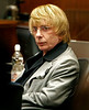 Infamous Record Producer, Phil Spector sports a blonde wig during his murder trial at the Foltz Criminal building in Los Angeles.