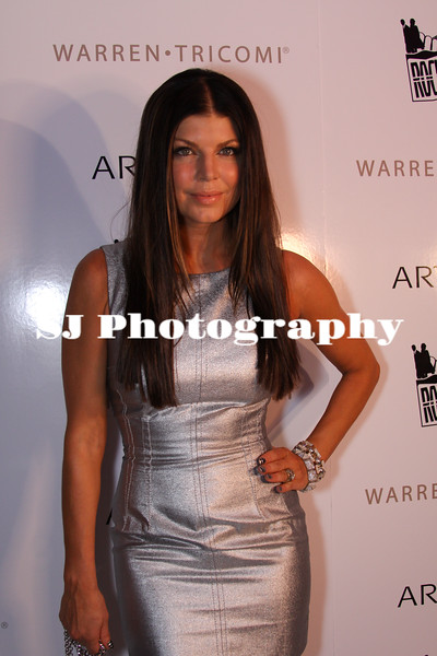 Fergie<br /> Singer (from Black Eye Peas), songwriter, fashion designer, model and actress<br /> Celebrating her 34th birthday at Liv night club<br /> Rock Fashion Week at the Fountainebeau, Miami Beach<br /> After Hours Red Carpet Event - Outside of Liv night club<br /> Miami Beach, Florida USA - 27.03.09
