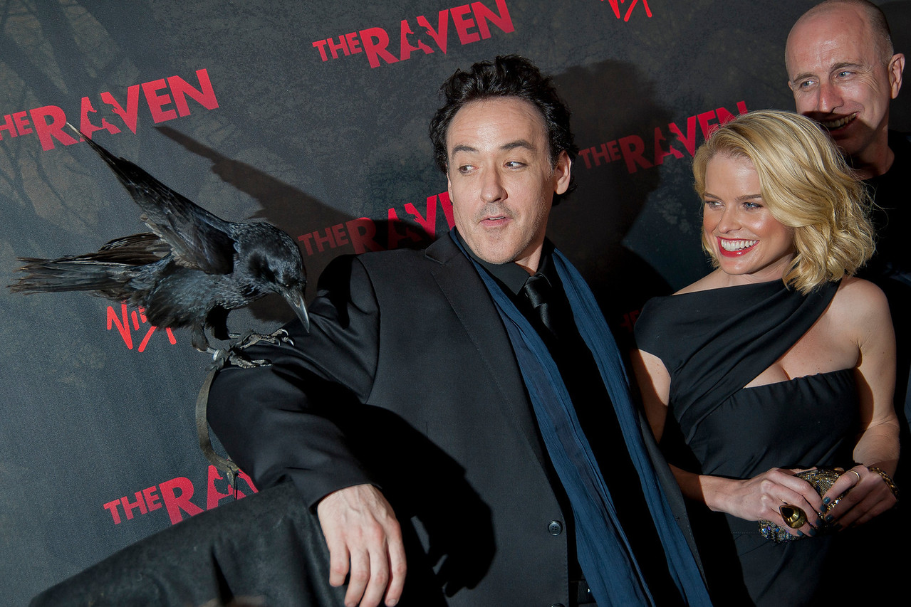 LOS ANGELES, CA - APRIL 23: (L-R) Actors John Cusack, Alice Eve and director James McTeigue arrive at the Los Angeles premiere of Relativity Media's 'The Raven' held at the Los Angeles Theatre on April 23, 2012 in Los Angeles, California. Photo taken by Tom Sorensen/Moovieboy Pictures.