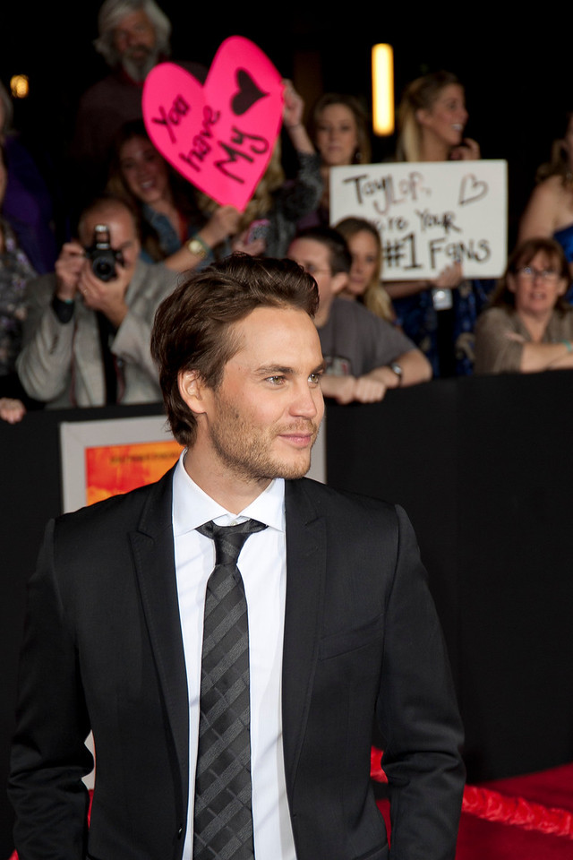 LOS ANGELES, CA - FEBRUARY 22: Actor Taylor Kitsch arrives at the world premiere of Disney?s ?John Carter? on Wednesday. February 22, 2012 at Regal Cinemas in downtown Los Angeles. Photo taken by Tom Sorensen/Moovieboy Pictures.