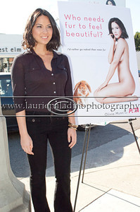 "Munn_1016 Actress Olivia Munn, the latest celebrity to pose nude for PETA's ""Id Rather Go Naked Than Wear Fur"" campaign, unveils her poster and billboard in Los Angeles, CA 11/12/2012 Photo credit mandatory: ©Laurie Paladino"