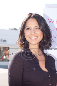"Munn_1029 Actress Olivia Munn, the latest celebrity to pose nude for PETA's ""Id Rather Go Naked Than Wear Fur"" campaign, unveils her poster and billboard in Los Angeles, CA 11/12/2012"