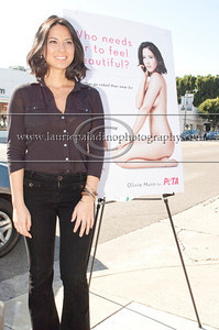 "Munn_1023 Actress Olivia Munn, the latest celebrity to pose nude for PETA's ""Id Rather Go Naked Than Wear Fur"" campaign, unveils her poster and billboard in Los Angeles, CA 11/12/2012"