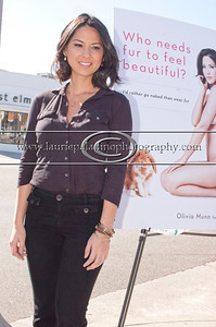 """Munn_1022 Actress Olivia Munn, the latest celebrity to pose nude for PETA's """"Id Rather Go Naked Than Wear Fur"""" campaign, unveils her poster and billboard in Los Angeles, CA 11/12/2012"""