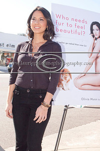 """Munn_1021 Actress Olivia Munn, the latest celebrity to pose nude for PETA's """"Id Rather Go Naked Than Wear Fur"""" campaign, unveils her poster and billboard in Los Angeles, CA 11/12/2012"""