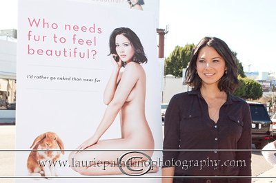 "Munn_1012 Actress Olivia Munn, the latest celebrity to pose nude for PETA's ""Id Rather Go Naked Than Wear Fur"" campaign, unveils her poster and billboard in Los Angeles, CA 11/12/2012"