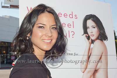 "Munn_1057 Actress Olivia Munn, the latest celebrity to pose nude for PETA's ""Id Rather Go Naked Than Wear Fur"" campaign, unveils her poster and billboard in Los Angeles, CA 11/12/2012"