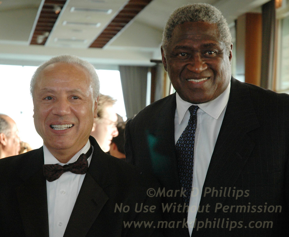 "New York Knicks coach Lenny Wilkins and Knicks great Willis Reed get together at the Arthur Ashe Institute for Urban Health's 10th Anniversary Sportsball held in New York April 29. Wilkens was honored with the ""Legacy in Motion"" Award for his work with charity.<br /> Photo by Mark D. Phillips"