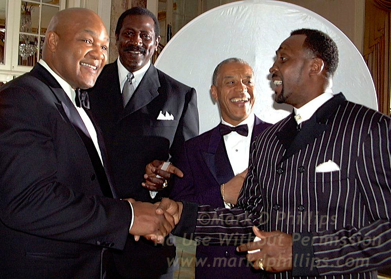 "George Foreman, former heavyweight champion, after receiving the Arthur Ashe Award for Community Service on April 21 at Sports Ball '98, the annual fund raising gala for the Arthur Ashe Institute for Urban Health (AAIUH) at the Waldorf Astoria in New York. With him are former 1968 Olympic teammate Spencer Haywood; Edgar Mandeville, CEO, The Arthur Ashe Institute for Urban Health, and fellow boxing great Thomas ""The Hit Man"" Hearns. For more info: Kathryn Hamilton  914-232-5446<br /> Photo by Mark D. Phillips    <a href=""http://www.stellarimages.com/sportsball"">http://www.stellarimages.com/sportsball</a>"