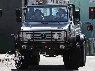 EXCLUSIVE: Arnold Schwarzenegger Doesn't Do Small Driving Custom Mercedes UNIMOG !