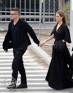 Brad Pitt and Angelina Jolie Romantically Hold Hands & Matching In Black Outfits in Santa Monica, LA