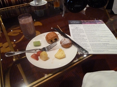 Captain's Club elite lounge breakfast: fruit skewer, pain au chocolat, mini jelly donut, mixed berry smoothie (EW) and a Celebrity Today. Every morning should start like this :)