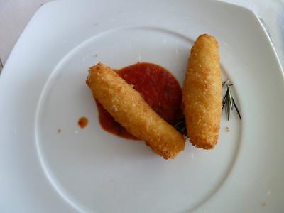 Fried mozzarella sticks with marinara sauce