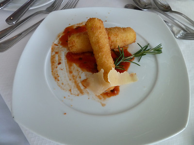 Fried mozzarella sticks with marinara sauce (Mom's serving was prettier)