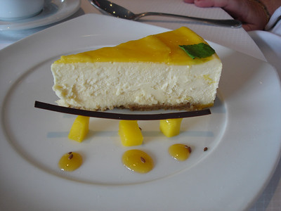 Mango cheesecake with lilikoi coulis