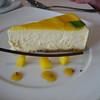 Mango cheesecake with lilikoi coulis