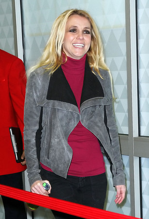 Non-Exclusive<br /> 2011 Dec 30 - Britney Spears carries a kiwi strawberry Snapple bottle as she jets out of JFK Airport with fiance Jason Trawick. Photo Credit Jackson Lee
