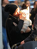 Non-Exclusive<br /> 2012 January 29 -  Marion Cotillard kisses baby Marcel lovingly while taking a walk in Soho, NYC with husband Guillaume Canet. Photo credit Jackson Lee