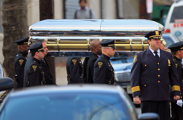 Non-Exclusive<br /> 2012 Feb 18 - Whitney Houston's chrome coffin gets carried by pallbearers to hearse on the way to be laid to rest at Fairview Cemetery in Newark, NJ. Photo Credit Jackson Lee
