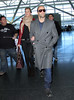 Non-Exclusive<br /> 2012 Feb 23 - Jason Statham and Rosie Huntington-Whiteley arrive at JFK Airport in NYC. Photo Credit Jackson Lee