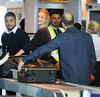 Non-Exclusive<br /> 2012 Feb 23 - Jason Statham takes off his sneakers as he goes through airport security with Rosie Huntington-Whiteley in NYC. Photo Credit Jackson Lee