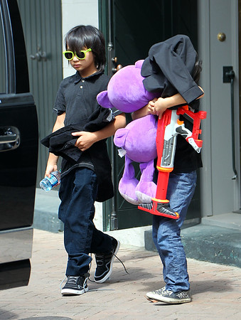Non-Exclusive<br /> 2012 Mar 11 - Maddox Pitt-Jolie step out in florescent shades with brother Pax Pitt-Jolie carrying a stuffed animal and large toy gun in New Orleans, LA. Photo Credit Jackson Lee