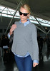 Non-Exclusive<br /> 2012 Mar 18 - Charlize Theron arrives at JFK airport in NYC. Photo Credit Jackson Lee