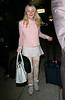Non-Exclusive<br /> 2012 Mar 18 - Dakota Fanning, wearing no makeup, arrives at JFK Airport in NYC. Photo Credit Jackson Lee