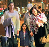 """Non-Exclusive<br /> 2012 Mar 20 - Suri Cruise puts up her dukes like the Notre Dame """"Fighting Irish"""" mascot with mom Katie Holmes and grandma Kathleen in NYC. Photo Credit Jackson Lee"""