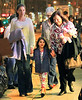 "Non-Exclusive<br /> 2012 Mar 20 - Suri Cruise puts up her dukes like the Notre Dame ""Fighting Irish"" mascot with mom Katie Holmes and grandma Kathleen in NYC. Photo Credit Jackson Lee"