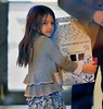 Non-Exclusive<br /> 2012 Mar 23 - Suri Cruise proudly carries her new build-a-bear in a big box after creating it at Build-a-Bear workshop in NYC. Photo Credit Jackson Lee