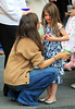 Non-Exclusive<br /> 2012 Mar 23 - Katie Holmes comforts a crying Suri Cruise outside of the Time Warner Center in NYC. Photo Credit Jackson Lee