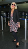 Non-Exclusive<br /> 2012 Apr 6 - Tori Spelling departs JFK Airport in NYC. Photo Credit Jackson Lee