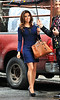 Non-Exclusive<br /> 2012 May 2 - Eva Longoria out and about in a sizzling blue dress showing lots of leg and two different handbags in rainy NYC. Photo Credit Jackson Lee