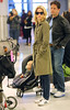 NON-Exclusive<br /> 2012 May 6 - Elizabeth Banks drags her son Felix in his baby seat behind her as she walks through JFK Airport in NYC. Photo Credit Jackson Lee