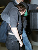 NON-Exclusive<br /> 2012 May 6 - Kristen Stewart blocks her face with a big box while in JFK airport in NYC. Photo Credit Jackson Lee