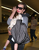 NON-Exclusive<br /> 2012 May 6 - Milla Jovovich and daughter Ever Gabo Anderson arrive at JFK Airport in NYC. Photo Credit Jackson Lee