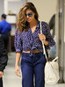 Exclusive<br /> 2012 May 6 - Ryan Gosling and Eva Mendes arrive at JFK Airport in NYC. Eva Mendes covered her face with her hair when she saw cameras. Photo Credit Jackson Lee