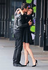 Non-Exclusive<br /> 2012 May 9 - Milla Jovovich kisses Carlos Casia Grande during the filming of a commercial of Avon in the Meatpacking District in NYC. Photo Credit Jackson Lee