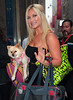 Non-Exclusive<br /> 2012 May 24 - Brooke Hogan gives her dog a walk in the rain in NYC. Photo Credit Jackson Lee