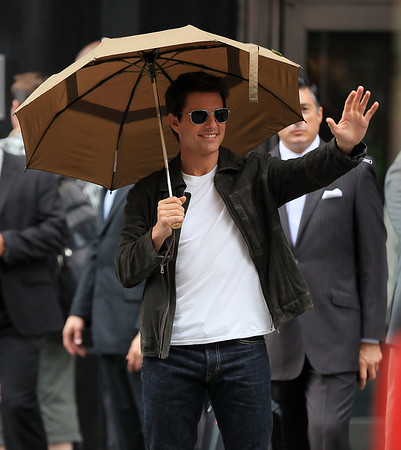 Non-Exclusive<br /> 2012 June 12 - Tom Cruise and Olga Kurylenko hold hands on the set of 'Oblivion' in NYC. Photo Credit Jackson Lee