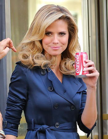 Non-Exclusive<br /> 2012 June 22 - Heidi Klum drinks a can of Coke during a break in commercial shoot in NYC. Photo Credit Jackson Lee